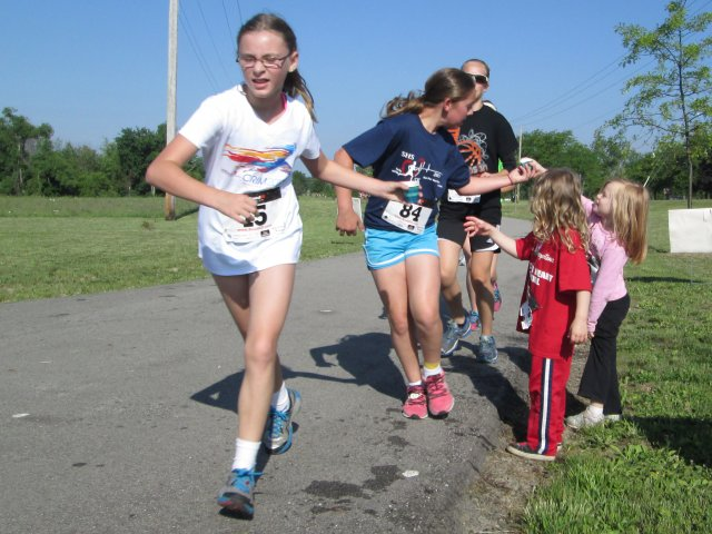 Water point on a fun run -- the little girls are the little sisters of the big girls.