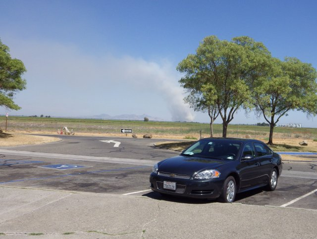 A wildfire burning near Willow, California in the distance behind the rental Chevy that carried us over 3000 miles. When I rent a car by the day I like to get my use out of it!