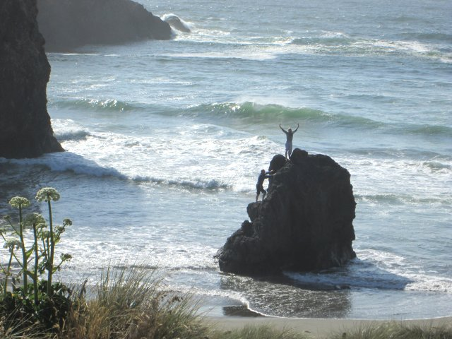 This girl on top of a sea stack near Brookings, Oregon, sure seems to feel exultant over the fact that she climbed on top to survey the scenery.