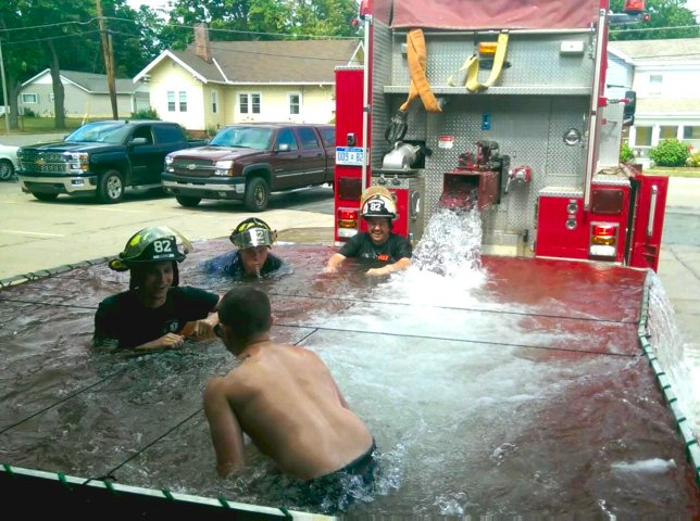 Catching up on summer Photoposts. Firemen make good use of the surge tank after a hot day of training.