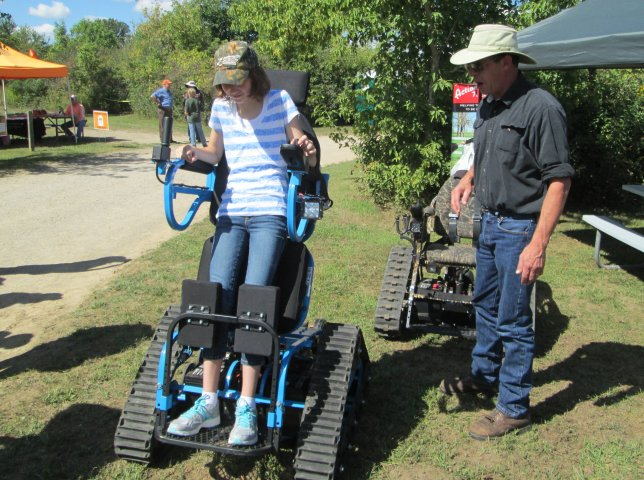 Catching up on summer Photoposts. A girl tries out a tracked all-terrain wheelchair at the Great Outdoors Youth Jamboree at Lake Hudson, MI last fall. No child left inside!